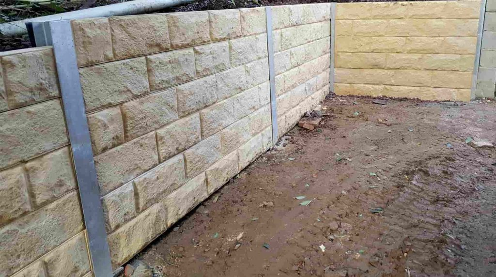 Concrete sleeper retaining wall - Sandstone pattern