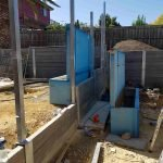 Concrete sleeper retaining wall being built