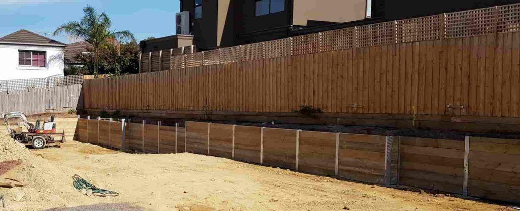 Long timber sleeper retaining wall