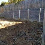 concrete stone block pattern retaining wall being built