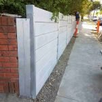 concrete wall at front of property