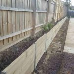 finished timber sleeper retaining wall with metal i beam posts