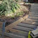 garden retaining wall and stairs being built