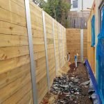 high timber retaining wall with metal posts