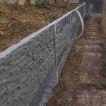 rock pattern concrete sleeper retaining wall