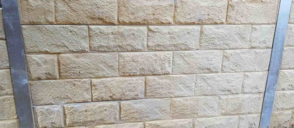 sandstone pattern concrete sleeper retaining wall