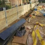 timber sleeper retaining wall being built